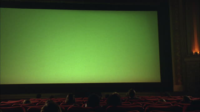 an audience watches a green screen at the grand lake theater in oakland, california. - film screening stock videos & royalty-free footage
