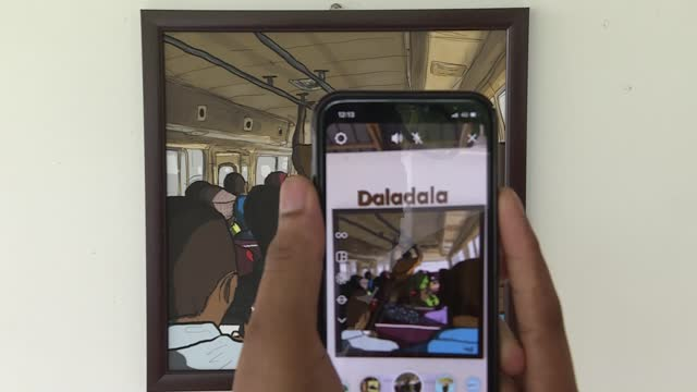 """an augmented reality exhibition titled """"the streets of dar es salaam"""" is taking art in tanzania to a whole new level. the exhibition allows visitors... - タンザニア点の映像素材/bロール"""
