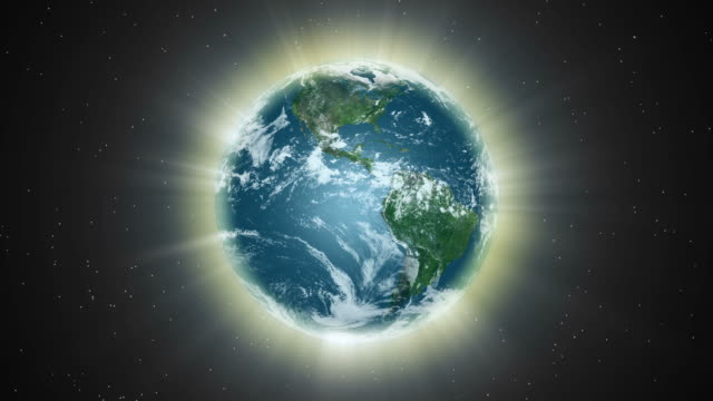 an aura of light envelopes the earth (loop). - earth goddess stock videos & royalty-free footage