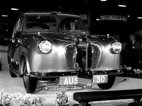 an austin 7 splits in two at the earls court motor show. - earls court stock videos & royalty-free footage
