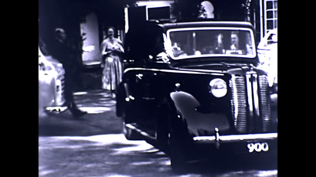 an austin a10 / fl1 and a peugeot 403 drive away - guest stock videos & royalty-free footage