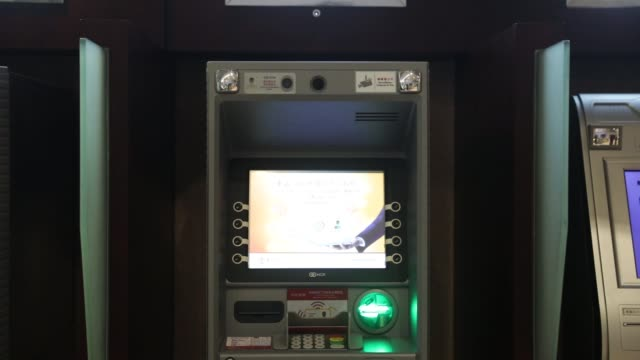 An automated teller machine equipped with facialrecognition software center stands at a bank branch in Macau China on Wednesday May 17 Signage...