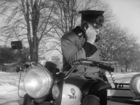 an automobile association patrolman receives a radio message from aa hq to respond to a roadside assistance. - roadside stock videos & royalty-free footage
