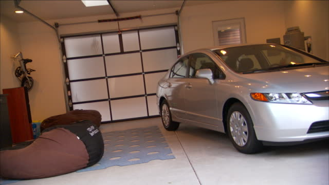 an automobile in a future home interior room demonstrates maximize utility and convenient use of space. - utility room stock videos and b-roll footage