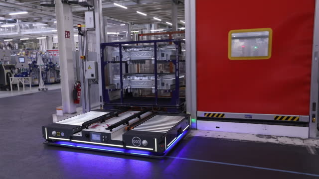 an autonomous assembly line vehicle operates at the volkswagen ag automobile factory in wolfsburg germany on friday march 1 2019 - wolfsburg lower saxony stock videos and b-roll footage