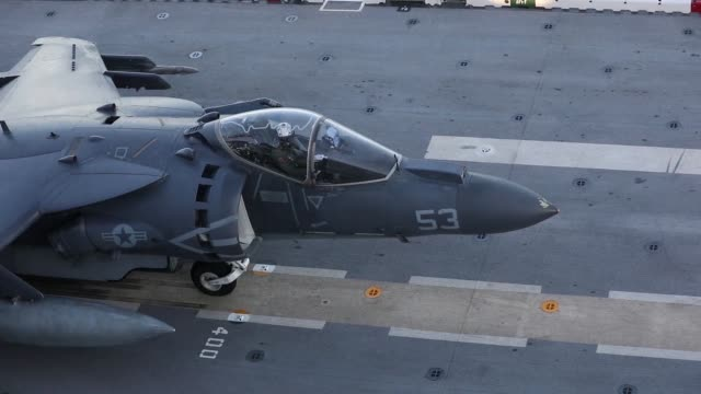 An AV8B Harrier lands and takes off from the flight deck of the Waspclass amphibious assault ship USS Kearsarge in the Atlantic Ocean during the...