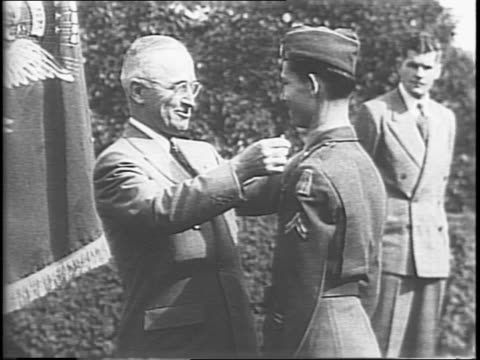 An award ceremony on the White House lawn / group of Congressional Medal of Honor recipients seated / General Omar N Bradley shaking hands with the...