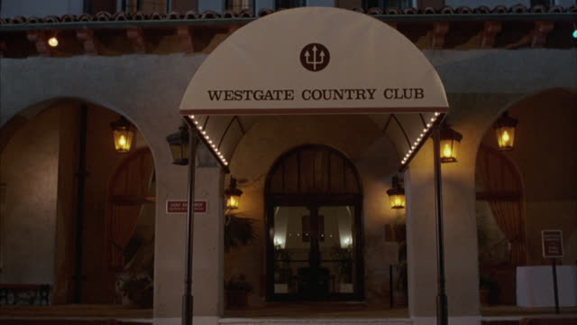 An awning hangs over the entrance of the Westgate Country Club.