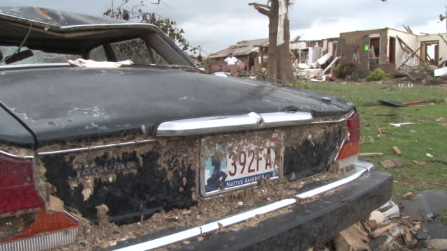 vídeos de stock e filmes b-roll de an early model jaguar is completely destroyed along with residential homes in the town of moore oklahoma in the wake of the devastating ef5 tornado... - 2013