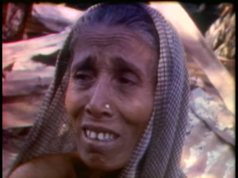 an east pakistani woman cries in the aftermath of violence wrought in her village by pakistani troops. - (war or terrorism or election or government or illness or news event or speech or politics or politician or conflict or military or extreme weather or business or economy) and not usa stock videos & royalty-free footage