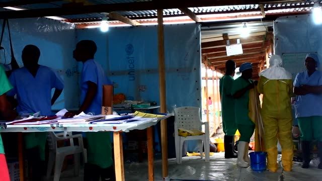 vídeos y material grabado en eventos de stock de an ebola epidemic has raged in west africa principally in guinea liberia and sierra leone for almost a year claiming the lives of more than 6500... - ébola