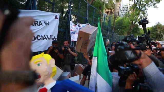 an effigy of donald trump hangs from a tree during protest against us president elect donald trump after being sworn in at mexican us embassy on... - papier stock videos & royalty-free footage