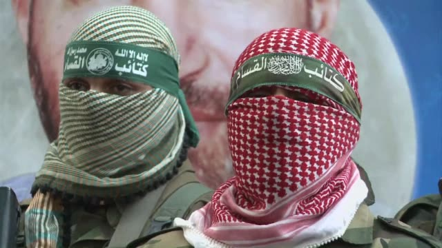 an egypt brokered truce took hold in the gaza strip on thursday after a week of bitter fighting between militant groups and israel clean al qassam... - militant groups stock videos and b-roll footage