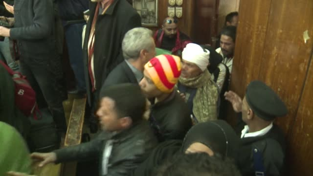 An Egyptian court on Monday acquitted 26 men accused of debauchery after their nighttime arrest from a Cairo bathhouse for suspected homosexual...