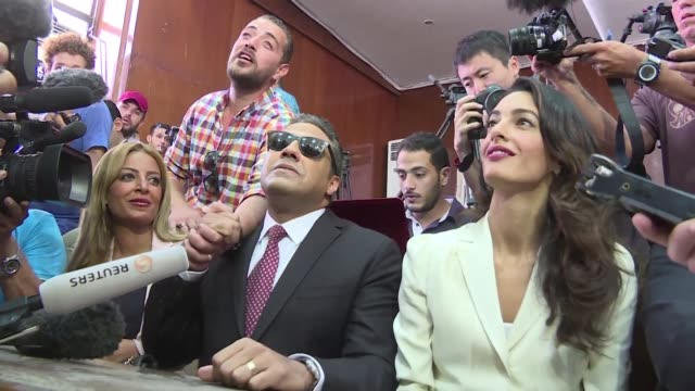 an egyptian court sentenced three al jazeera reporters to three years in prison on saturday in a shock ruling following global demands for their... - acquittal stock videos and b-roll footage