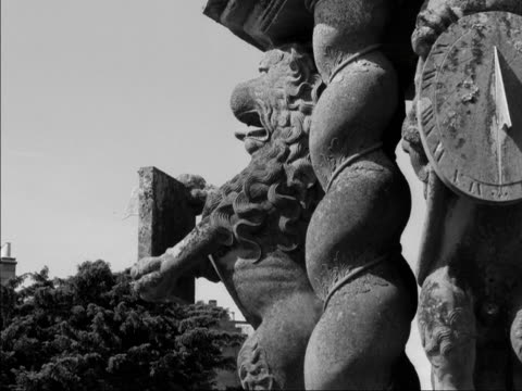 stockvideo's en b-roll-footage met an elaborate stone sundial stands in the grounds of glamis castle - zonnewijzer