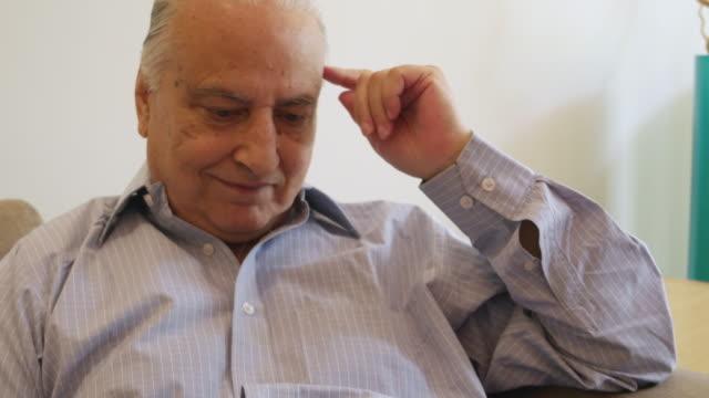 An elder gentleman browsing on a tablet