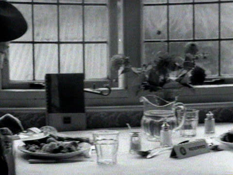 an elderly couple enjoy a cooked meal in a restaurant october 1954 - couple relationship stock videos & royalty-free footage
