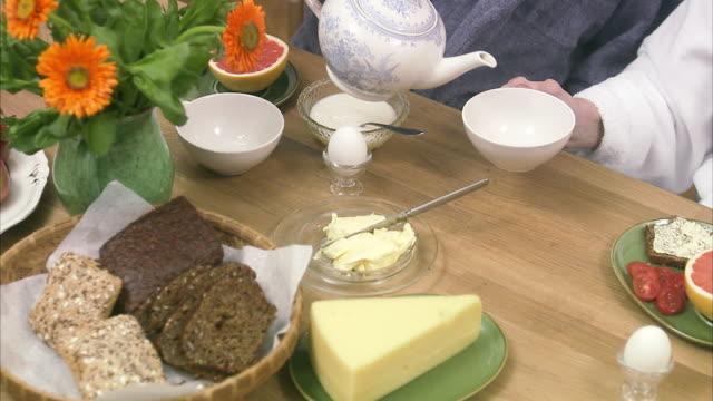 an elderly couple having breakfast sweden. - ausgusstülle stock-videos und b-roll-filmmaterial