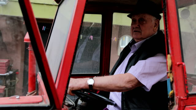 an elderly farmer riding his tractor - tractor stock videos and b-roll footage