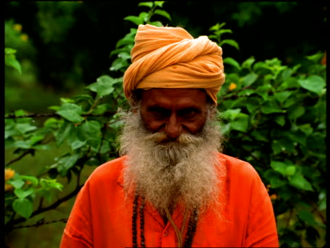 an elderly indian man with a beard wears a turban. - turban stock videos & royalty-free footage