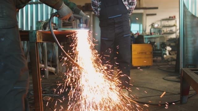 an elderly man cutting metal - steel stock videos & royalty-free footage