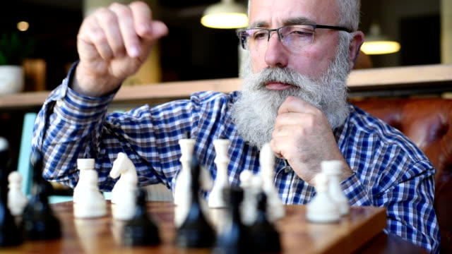 an elderly man playing with himself in chess - plaid shirt stock videos & royalty-free footage