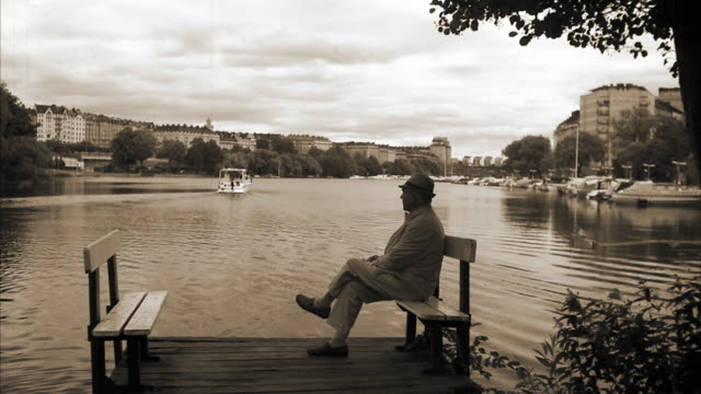 An elderly man sitting by the sea Stockholm Sweden.