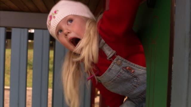 an elderly man with granddaughter in a playground sweden. - bib overalls stock videos and b-roll footage