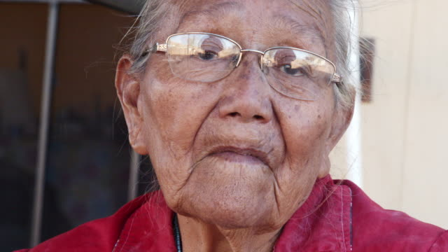 an elderly navajo grandmother and matriarch at her home in monument valley arizona navajo reservation - indigenous north american culture stock videos & royalty-free footage