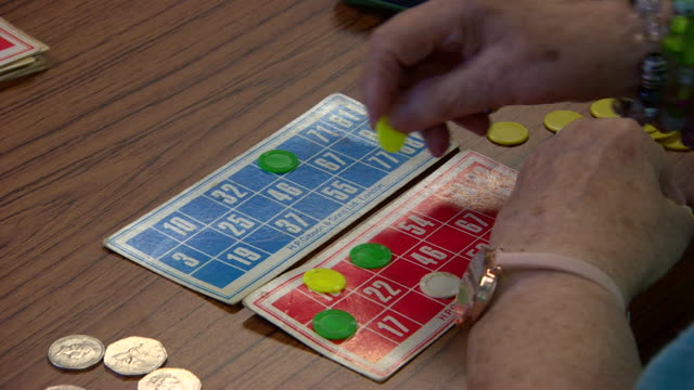 stockvideo's en b-roll-footage met an elderly person playing bingo in a care home - bingo