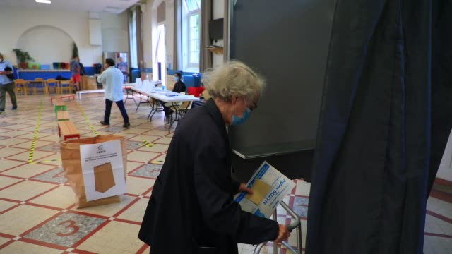 an elderly person walks to a voting booth in a polling station in the 15th arrondissement of paris during the second round of mayoral elections on... - politics illustration stock videos & royalty-free footage