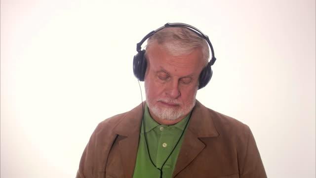 An elderly Scandinavian man with headphones Sweden.