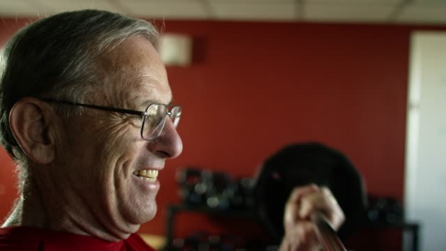 an elderly white man weight lifts with a barbell at a gym - bicep stock videos & royalty-free footage