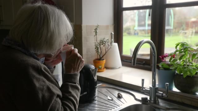 an elderly woman is seen at home on january 11, 2018 in bristol, england. the growing cost and how to fund social care for the expanding elderly... - one person stock videos & royalty-free footage