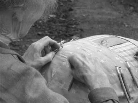 an elderly woman makes lace outside her home in the village of honiton, devon. - sewing stock videos & royalty-free footage
