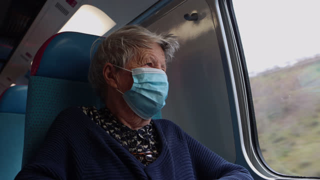 an elderly woman on a train with a protective mask to join her family for the christmas holidays on december 17, 2020 in france. france lifted the... - grey hair stock videos & royalty-free footage