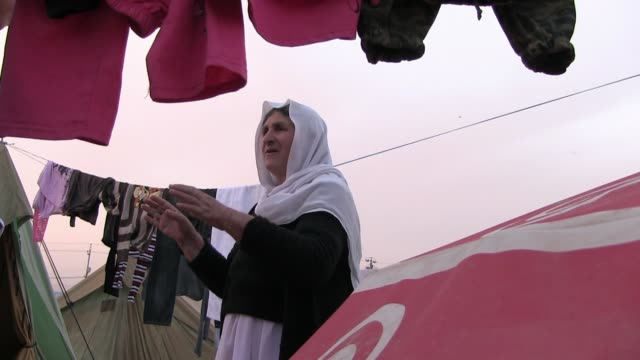 an elderly yazidi woman shares her story at a refugee camp for displaced people from the minority yazidi sect which were driven from their homes in... - sinjar mountains stock videos & royalty-free footage