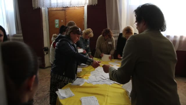 ms an election official counts votes in a polling station in the lenin palace of culture in slovyansk in eastern ukraine following the closing of... - eastern european culture stock videos & royalty-free footage