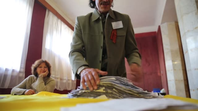an election official counts votes in a polling station in the lenin palace of culture in slovyansk in eastern ukraine following the closing of polls... - eastern european culture stock videos & royalty-free footage