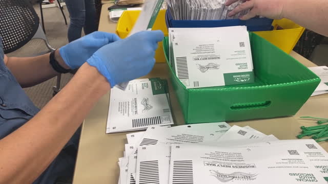 an election worker sorts submitted ballots in provo, ut, u.s. on tuesday, november 3, 2020 . utah is one of several states that have moved to mail in... - provo stock videos & royalty-free footage