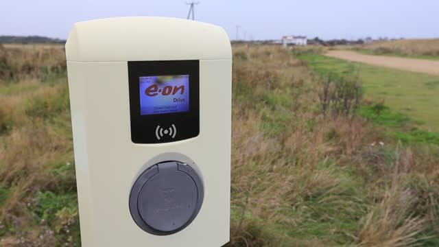 an electric car charging point at spurn point nature reserve car park, yorkshire, uk. - nature reserve stock videos & royalty-free footage