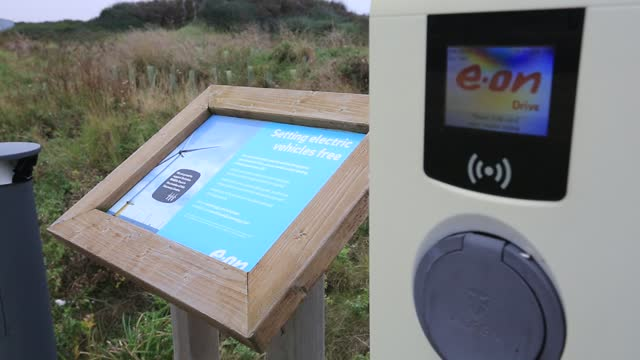 an electric car charging point at spurn point nature reserve car park, yorkshire, uk. - national park stock videos & royalty-free footage