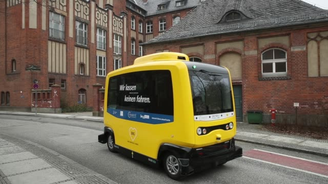 an electric minibus with autonomous driving ability is displayed at the charite hospital and medical campus during a press event on march 26 2018 in... - driverless transport stock videos & royalty-free footage