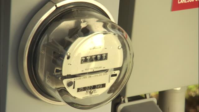 vídeos y material grabado en eventos de stock de an electricity meter records usage. - medidor