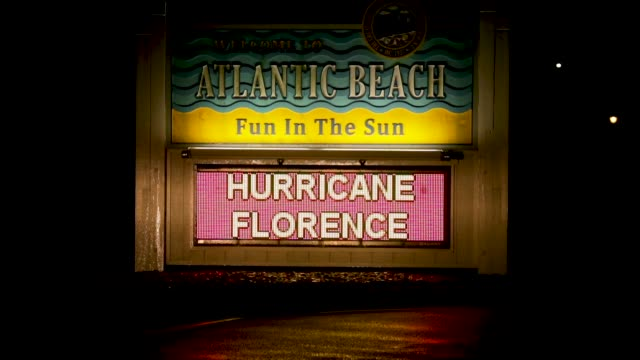 an electronic sign warns residents to evacuate atlantic beach ahead of the arrival of hurricane florence september 13 2018 in atlantic beach north... - atlantic beach north carolina stock videos & royalty-free footage