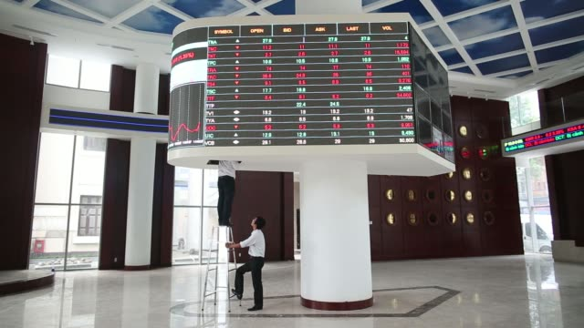 an electronic stock ticker displays share prices in the new ho chi minh stock exchange in ho chi minh city vietnam on monday june 2 an electronic... - vietnam meridionale video stock e b–roll