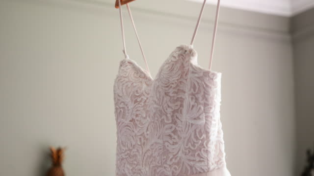 an elegant wedding dress - hanging up stock videos & royalty-free footage