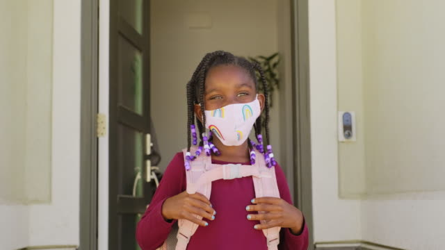 an elementary school student going to school with face mask - back to school stock videos & royalty-free footage