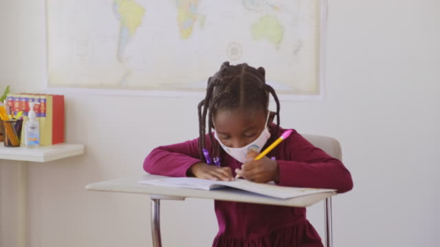 an elementary school student in a classroom - back to school stock videos & royalty-free footage